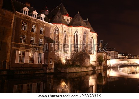 The St. Michielskerk with reflection in the water in Ghent, Belgium. During the Festival of Lights. - stock photo