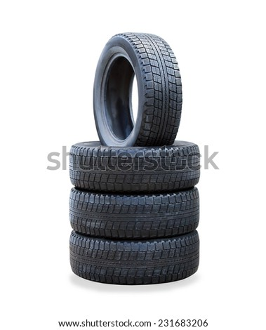 The stack of four winter new tires over white - stock photo