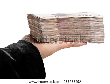 The stack of money in women's hands - stock photo
