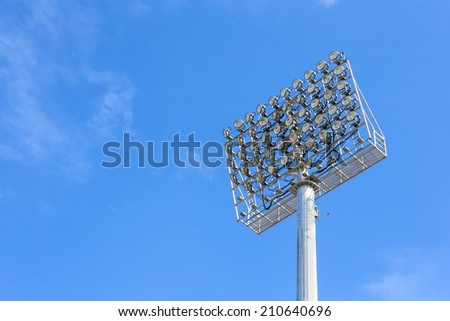 The Stadium Spot-light tower with Blue Sky - stock photo