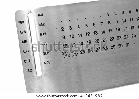 The Stainless Steel Calendar Isolated on the White Background - stock photo