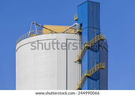 The stairs to the top of the big silo - stock photo