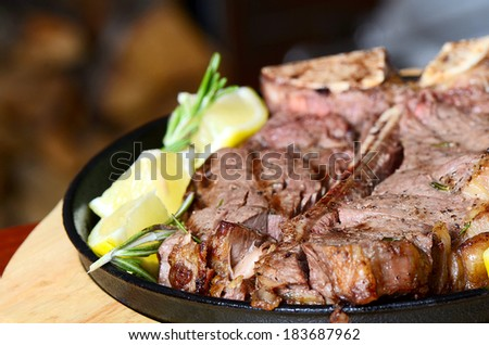 the stake from mutton with a lemon - stock photo