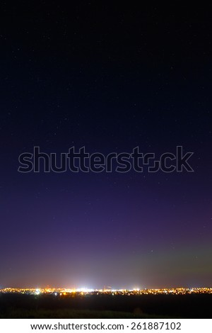 The starry sky above the lighted lanterns city. blur - stock photo
