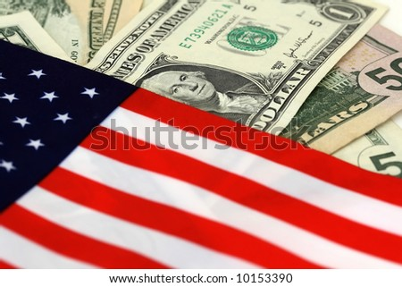 The stars and stripes with dollar bills of the USA - stock photo