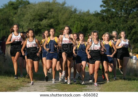 The start of a girls cross country meet. High School. Editorial use only. - stock photo