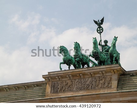 The statue at the top of brandenburg gate in Berlin, Germany - stock photo