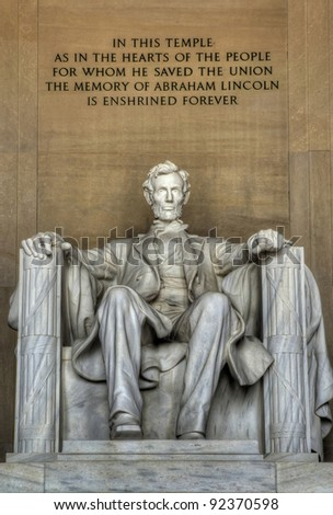 The statue of Abraham Lincoln inside Lincoln Memorial. - stock photo