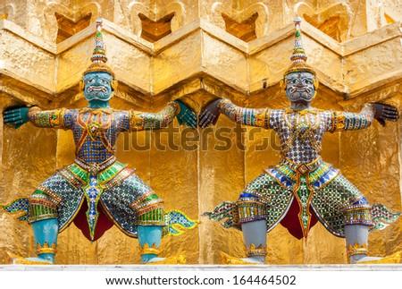 The statue of Daemon Guardians at Wat Phra Kaew in Bangkok - stock photo