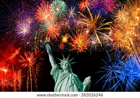 The Statue of Liberty and July 4th fireworks  - stock photo
