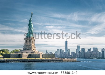 The statue of Liberty and Manhattan, New York City - stock photo