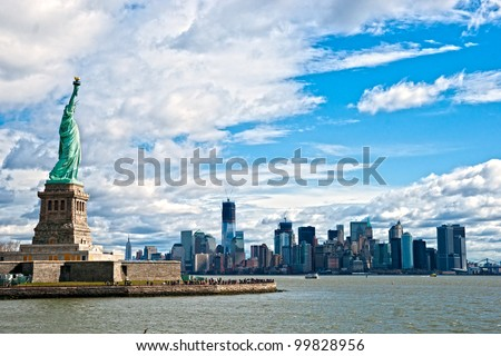 The Statue of Liberty and Manhattan Skyline, New York City. USA. - stock photo