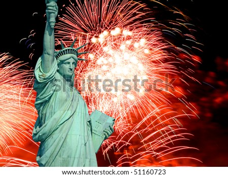 The Statue of Liberty and 4th of July fireworks - stock photo