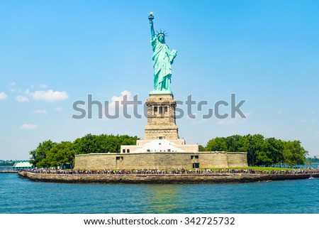 The Statue of Liberty at Liberty Island in New York City on a beautiful summer day - stock photo