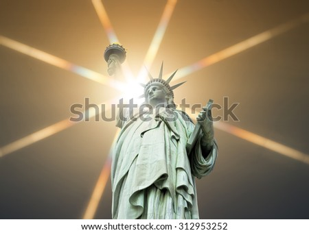 The Statue of Liberty in New York, USA, with sun effect - stock photo