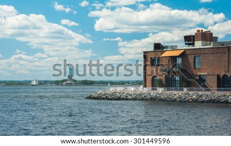 The Statue of Liberty on Liberty Island in New York Harbor in New York City, in the United States - stock photo