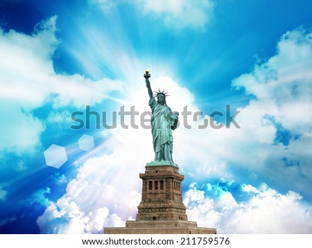 the statue of liberty on the heaven background. - stock photo
