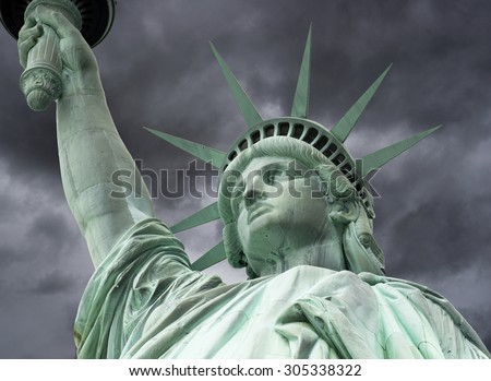 The Statue of Liberty with stormy clouds, New York City, June 2015 - stock photo