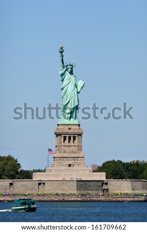 The Statue of Liberty with tourists. - stock photo
