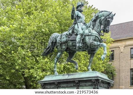 The statue of William I (Prince of Orange or Willem van Oranje) opposite Noordeinde Palace in The Hague, Netherlands. - stock photo
