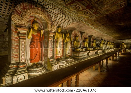 The statues of Lord buddha in cave temple at Dambulla in Sri Lanka - stock photo