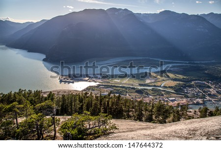 The Stawamus Chief is the second largest granite monolith in the world, a mecca for rock climbers. For hikers its a short but strenuous hike to the summit with a spectacular view of Squamish  - stock photo