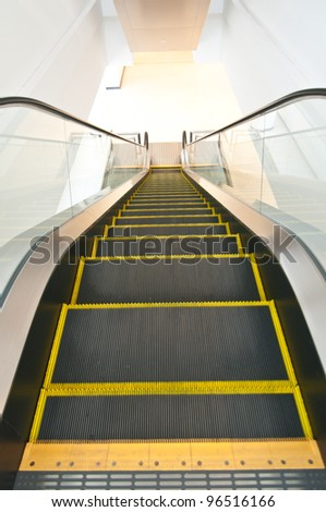 The steel automatic escalators in a big department store - stock photo