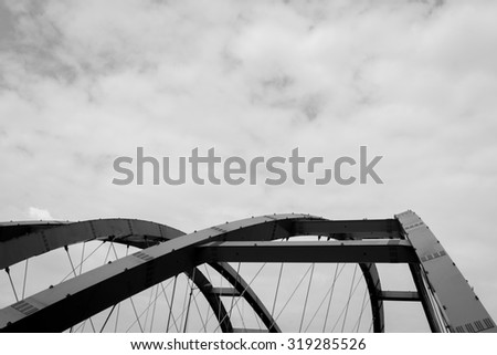 The steel construction of red bridge. Black and white  - stock photo