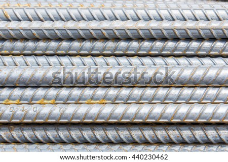 The steel deform bar or steel rod  pile on the construction site with corrosion which cause the rusty. - stock photo