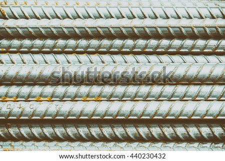 The steel deform bar or steel rod pile on the construction site with the corrosion  in vintage scene. - stock photo