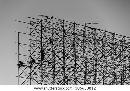 The steel frame construction of large banners on black and white background.