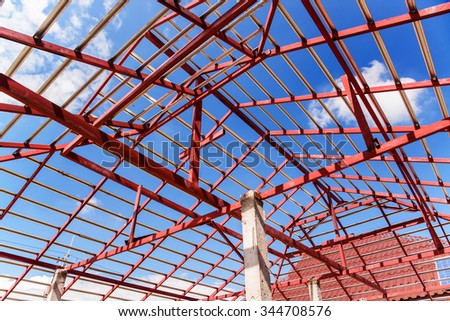 The steel structure beam on roof of building residential construction. - stock photo