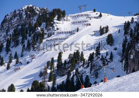 The steepest groomed ski slope in Austrian Alps, called Harakiri, in Mayrhofen ski resort. - stock photo