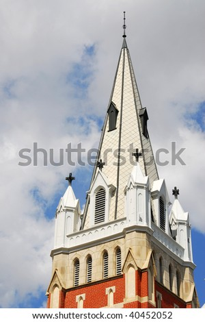 The steeple of a historic catholic church under the blue sky in downtown Edmonton, Alberta, Canada - stock photo