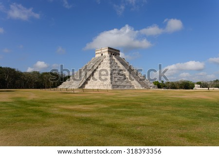 The stepped pyramids, temples, columned arcades, and other stone structures of Chichén Itzá were sacred to the Maya and a sophisticated urban center of their empire from A.D. 750 to 1200. - stock photo