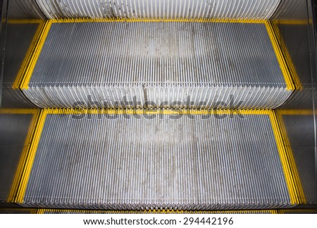 The steps of the escalator in the metro two pieces of steel - stock photo