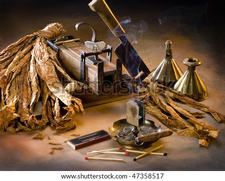 the still life with old cutter on the tobacco - stock photo