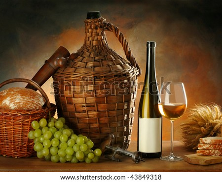 The still-life with white wine and vine - stock photo