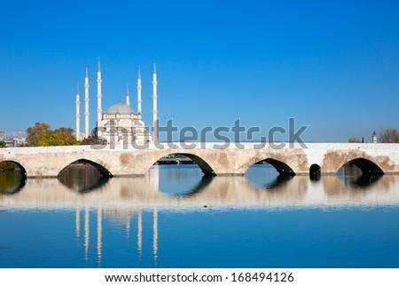 The Stone Bridge and Sabanci Mosque, Adana, Turkey  - stock photo