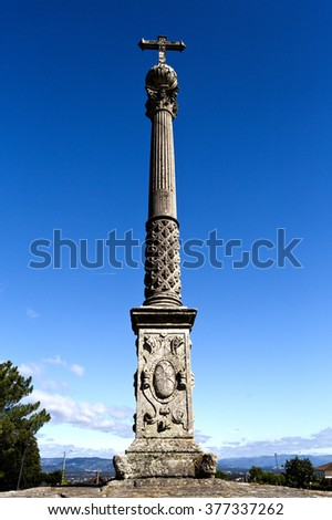 The Stone Cross of Tibaes is a Renaissance monument comprising a Corinthian column and capital with a sphere and a Latin cross on top.