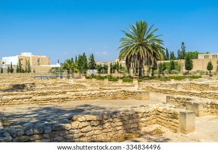 The stone foundations of the Roman villas are the part of the large archaeological site of El Jem, Tunisia. - stock photo
