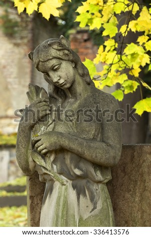 The stone Girl on Tomb from the autumn old Prague Cemetery, Czech Republic - stock photo