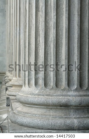 The stone pillars of justice will always offer safety - stock photo