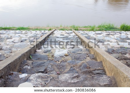 The stone way to the river , lake , cement way