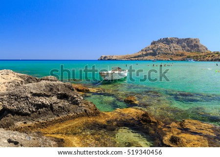 The stony beach at Rhodes Charaki, golden sand