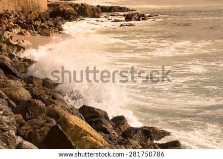 The stony shores of the Atlantic Ocean. Portugal. Toned. - stock photo