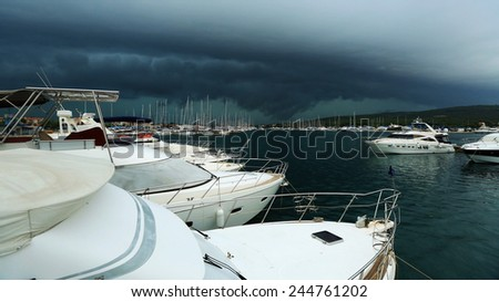 The storm over the harbor with yachts, Stormy sky over sailboats anchored in a marina, Croatia