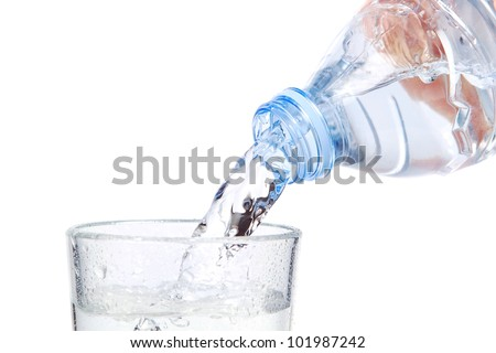 The stream of water flowing into the bottle. On a white background. - stock photo