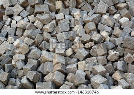 The street detail with pile of cobblestones  - stock photo