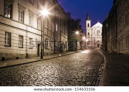 The street of the old town in Warsaw at night  - stock photo